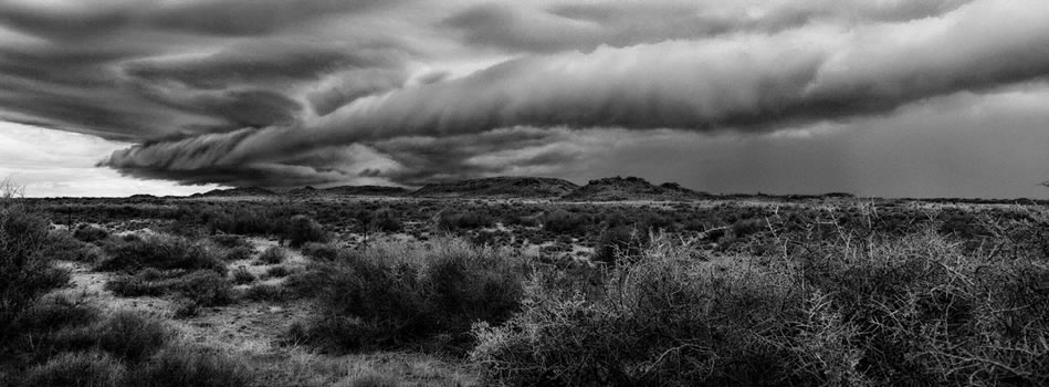 1. Departing storm over dolerite outcrops, Loxton – Northern Cape – 325 grams fiber fine art giclee archival print – 1/15